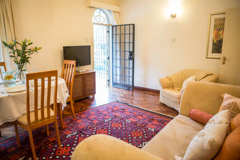 Pool House Living and Dining Room - Furnished Apartments in Nairobi
